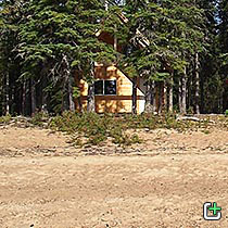 Nahanni Mountain Lodge cabin in the trees