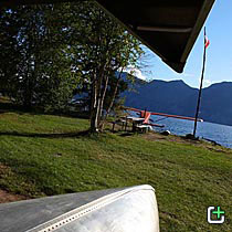Nahanni Mountain Lodge cabin lawn